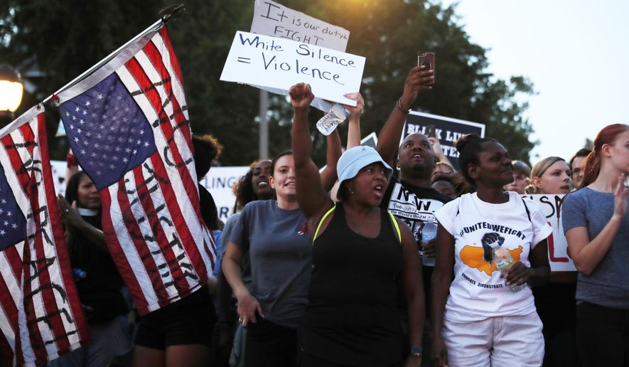 Demonstrators march in response to a not guilty verdict in the trial of former St. Louis police officer Jason Stockley Saturday, Sept. 16, 2017, in St. Louis. Stockley was acquitted in the 2011 killing of a black man following a high-speed chase. (AP Photo/Jeff Roberson)