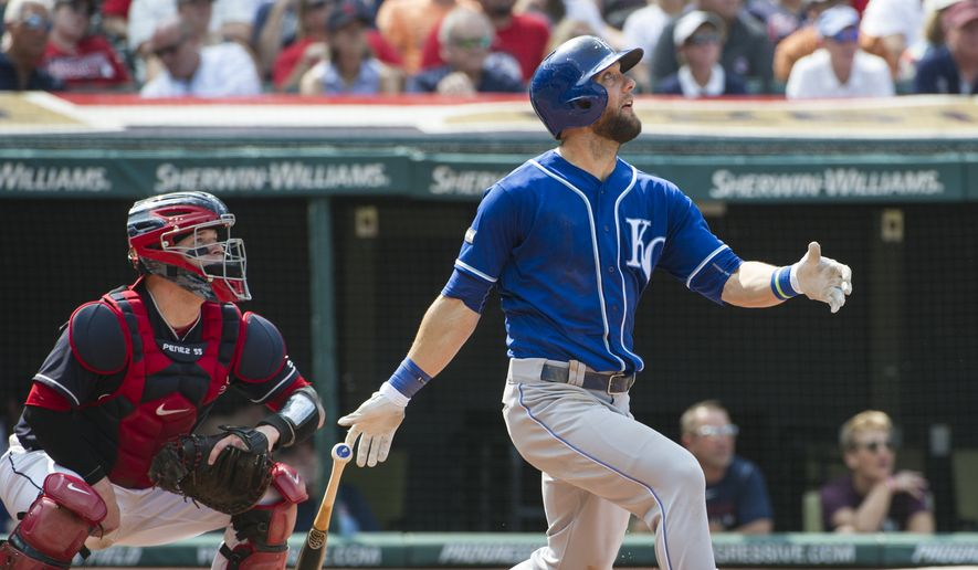 Kansas City Royals batterAlex Gordon and Cleveland Indians catcher Roberto Perez watch his fly ball during a baseball game in Cleveland, Sunday, Sept. 17, 2017. (AP Photo/Phil Long) **FILE**