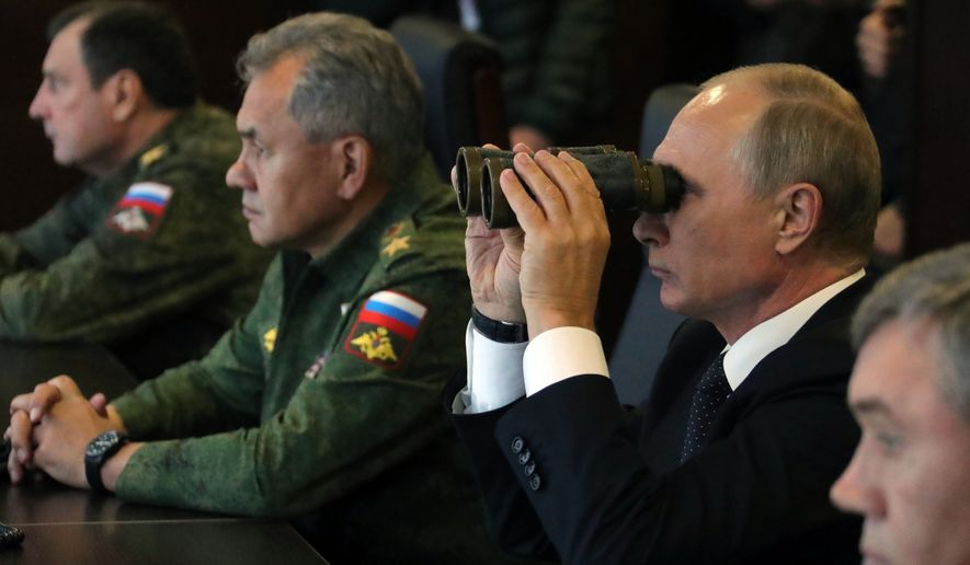 Russian President Vladimir Putin, second right, Defence Minister Sergei Shoigu, second left, and Chief of the General Staff of the Russian Armed Forces Valery Gerasimov, right, watch a military exercise at a training ground at the Luzhsky Range, near St. Petersburg, Russia, Monday, Sept. 18, 2017. The Zapad (West) 2017 maneuvers have caused concern among some NATO members neighboring Russia, who have criticized a lack of transparency about the exercises and questioned Moscow's real intentions. (Mikhail Klimentyev, Sputnik, Kremlin Pool Photo via AP)