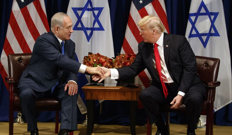 President Donald Trump shakes hands with Israeli Prime Minister Benjamin Netanyahu during a meeting at the Palace Hotel during the United Nations General Assembly, Monday, Sept. 18, 2017, in New York. (AP Photo/Evan Vucci)