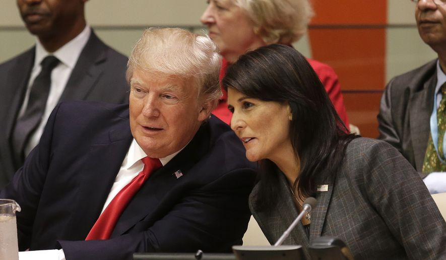 United States President Donald Trump speaks with U.S. Ambassador to the United Nations Nikki Haley before a meeting during the United Nations General Assembly at U.N. headquarters, Monday, Sept. 18, 2017. (AP Photo/Seth Wenig)