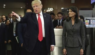 President Donald Trump, accompanied by U.S. Ambassador Nikki Haley, arrives at the United Nations, Monday, Sept. 18, 2017. (AP Photo/Richard Drew)