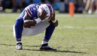 Buffalo Bills' Tyrod Taylor (5) reacts to an incomplete pass on fourth down in the final seconds in the second half of an NFL football game against the Carolina Panthers in Charlotte, N.C., Sunday, Sept. 17, 2017. (AP Photo/Bob Leverone)