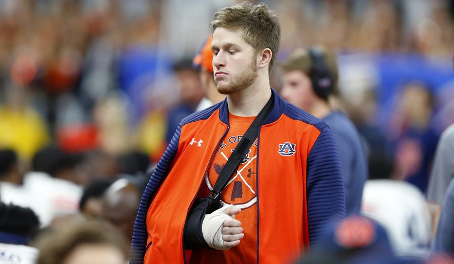 FILE - In this Jan. 2, 2017, file photo, Auburn quarterback Sean White walks on the sideline with his arm in a cast and sling in the second half of the Sugar Bowl NCAA college football game against Oklahoma in New Orleans. Auburn backup quarterback Sean White has been arrested on a charge of public intoxication. Jail records show that the 21-year-old White was taken to the Lee County Detention Center at 3:28 a.m. Sunday, Sept. 17, 2017. (AP Photo/Butch Dill, File)