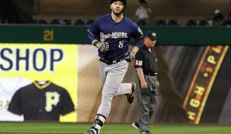 Milwaukee Brewers' Ryan Braun rounds second after hitting a solo home run off Pittsburgh Pirates starting pitcher Jameson Taillon in the fourth inning of a baseball game, Monday, Sept. 18, 2017 in Pittsburgh. (AP Photo/Gene J. Puskar)