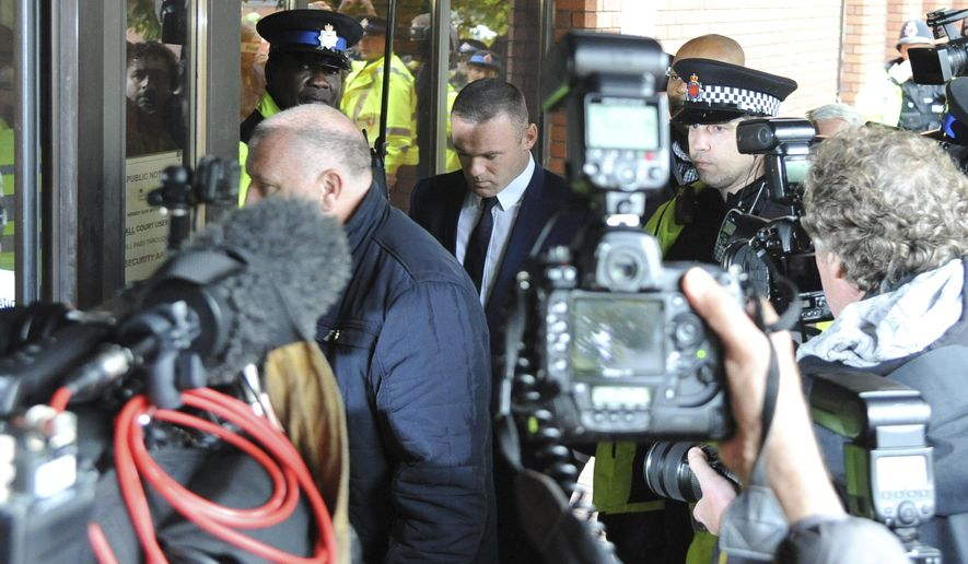 Wayne Rooney, centre arrives at Stockport Magistrates Court in Stockport, England, Monday, Sept. 18, 2017. The 31-year-old Everton striker is appearing in court on alleged drink driving charges. (AP Photo/Rui Vieira)