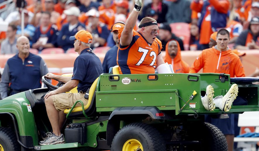 Denver Broncos offensive tackle Garett Bolles (72) is helped off the field after an injury against the Dallas Cowboys during the second half of an NFL football game, Sunday, Sept. 17, 2017, in Denver. Broncos coach Vance Joseph says rookie tackle Garett Bolles' left leg injury isn't as serious as first feared. Joseph says Bolles has a bone bruise in his lower left leg and is week to week. The Broncos' first-round draft pick was injured in Denver's win over Dallas. (AP Photo/Joe Mahoney)