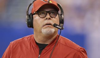 Arizona Cardinals head coach Bruce Arians looks at a replay during the first half of an NFL football game against the Indianapolis Colts, Sunday, Sept. 17, 2017, in Indianapolis. (AP Photo/Michael Conroy)