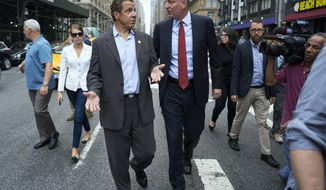 FILE - In this Sept. 18, 2016, file photo, New York Gov. Andrew Cuomo, left, and Mayor Bill de Blasio walk on West 23rd street in Manhattan's Chelsea neighborhood in New York. The governor endorsed his frequent rival and fellow Democrat for a second term as mayor of New York City, Monday, Sept. 18, 2017. De Blasio faces Republican state Assemblywoman Nicole Malliotakis of Staten Island in the November election. (AP Photo/Craig Ruttle, File)