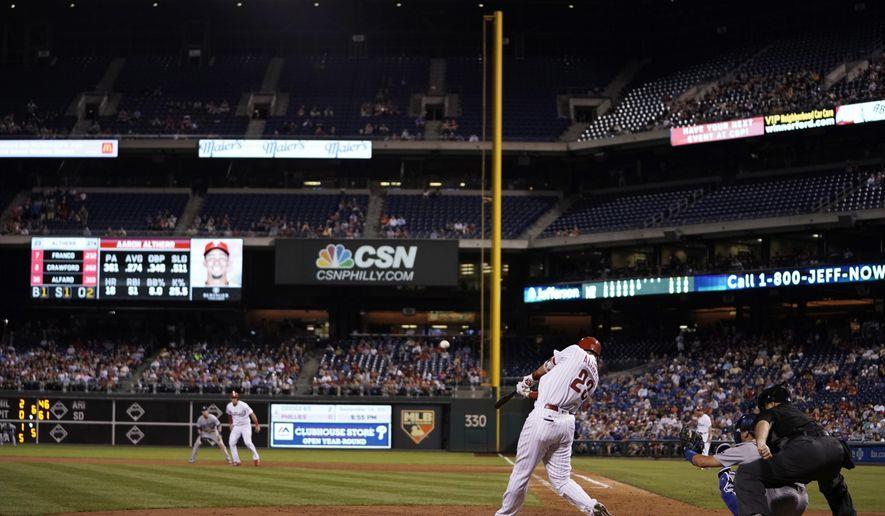 Philadelphia Phillies' Aaron Altherr hits a grand slam off Los Angeles Dodgers starting pitcher Clayton Kershaw during the sixth inning of a baseball game, Monday, Sept. 18, 2017, in Philadelphia. Philadelphia won 4-3. (AP Photo/Matt Slocum)