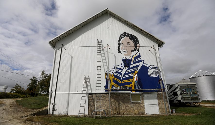 In this Thursday, Sept. 14, 2017, photo, Scott Hagan, known as the barn painter, paints an image of Commodore Oliver Hazard Perry on the side of a barn in Oak Harbor, Ohio. (Andy Morrison/The Blade via AP)