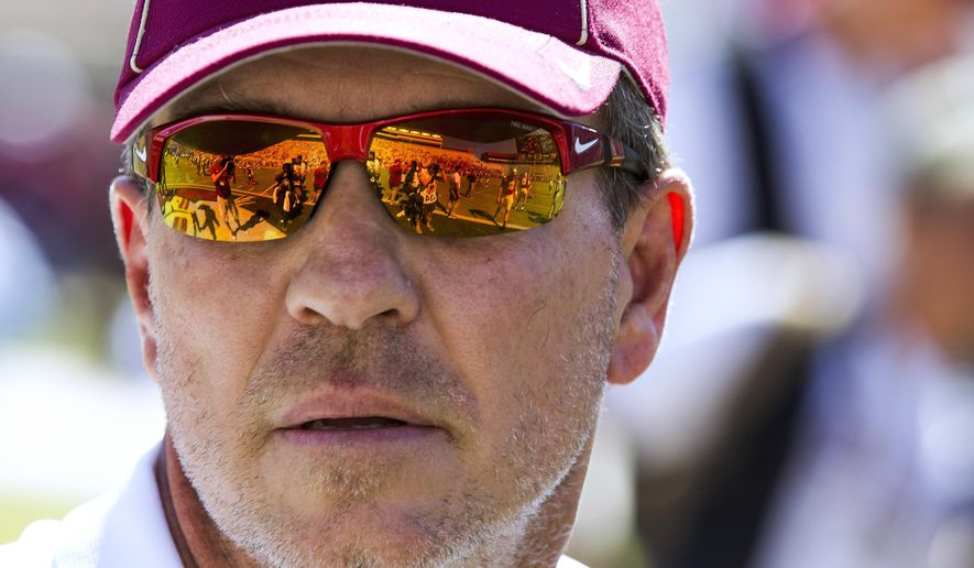 FILE - In this Saturday, Oct. 1, 2016, file photo, Florida State head football coach Jimbo Fisher watches his team warm up prior to an NCAA college football game against North Carolina in Tallahassee, Fla. No. 12 Florida State finally has a game to prepare for this week after not playing the previous two weeks due to Hurricane Irma. Saturday's game against North Carolina State begins a stretch where the Seminoles will be playing 10 straight weeks. (AP Photo/Mark Wallheiser, File)