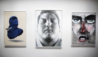 The paintings, from left: 'Shirt Mask x Paper Plane' by Numo Viegas, 'The Fighter' by El Mac and 'Street Face' by Lister displayed inside the exhibition of the new Urban Nation Museum for Urban Contemporary Art in Berlin, Germany, Monday, Sept. 18, 2017. The opening exhibition, which will last for around nine months, aims to introduce visitors to the culture of urban art. Director Yasha Young worked with eight curators from various countries to produce a show that explores strands including portraits, pop art and activism. (AP Photo/Markus Schreiber)