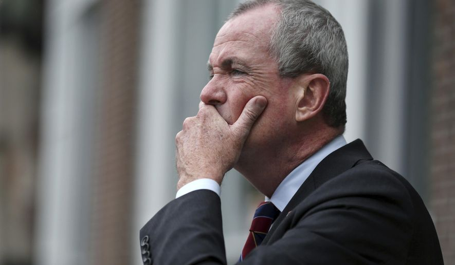 Democratic gubernatorial candidate Phil Murphy listens to a question as he addresses a gathering outside Mercer County Community College on Monday, Sept. 18, 2017, in Trenton, N.J. Murphy said Monday that the tuition-free community college plan he's promising could cost $400 million. (AP Photo/Mel Evans)