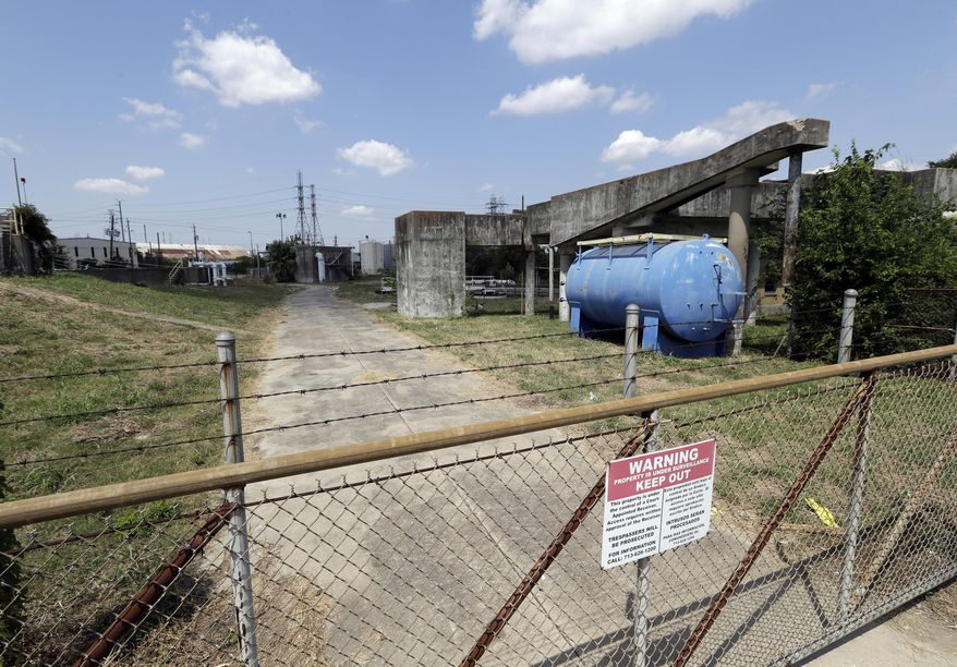 A gate at the U.S. Oil Recovery Superfund site is shown Thursday, Sept. 14, 2017, in Pasadena, Texas, where three tanks once used to store toxic waste were flooded during Hurricane Harvey. The Environmental Protection Agency says it has found no evidence that toxins washed off the site, but is still assessing damage.  (AP Photo)