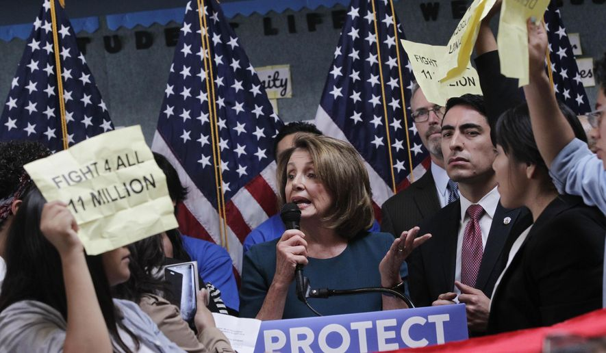 U.S. House Minority Leader Nancy Pelosi tries to talk as protesters demonstrate during a press conference on the DREAM ACT on Monday, Sept. 18, 2017 in San Francisco, Calif. Several dozen young immigrants shouted down Pelosi, the top Democrat in the U.S. House, on Monday during an event in San Francisco, following her recent conversations with President Donald Trump over the future of a program that grants many of them legal status. (Lea Suzuki /San Francisco Chronicle via AP)