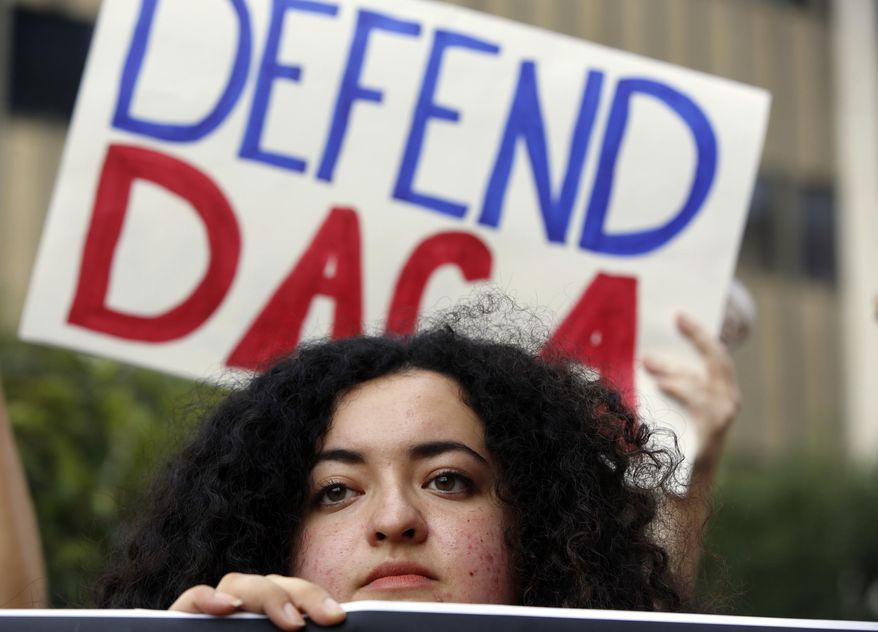 Loyola Marymount University student and dreamer Maria Carolina Gomez joins a rally in support of the Deferred Action for Childhood Arrivals, or DACA program, outside the Edward Roybal Federal Building in Los Angeles. Six immigrants brought to the United States as children who became teachers, graduate students and a lawyer are suing the Trump administration over its decision to end DACA, which is shielding them from deportation. (AP Photo/Damian Dovarganes, File)
