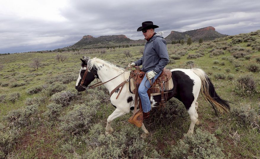 In this May 9, 2017, file photo, Interior Secretary Ryan Zinke rides a horse in the new Bears Ears National Monument near Blanding, Utah. (Scott G Winterton/The Deseret News via AP, File)