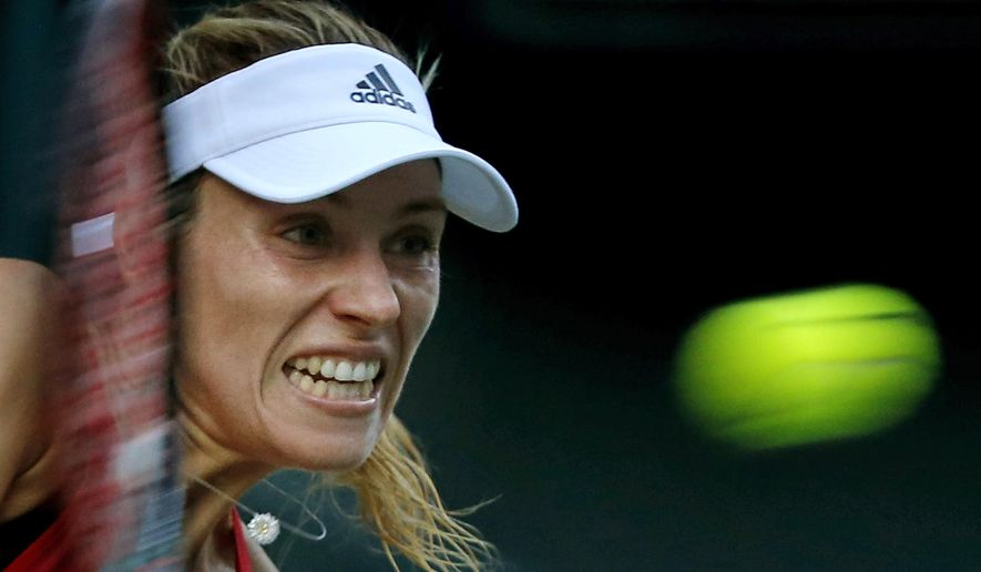 Angelique Kerber of Germany returns a shot to Naomi Osaka of Japan during their first round match of the Pan Pacific Open tennis tournament in Tokyo, Monday, Sept. 18, 2017. (AP Photo/Shizuo Kambayashi)