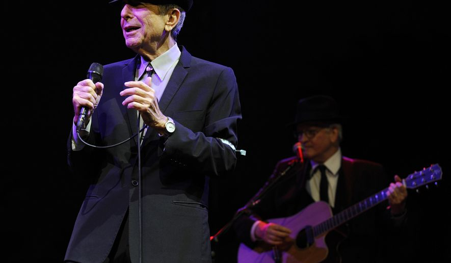 FILE - In this April 17, 2009, file photo, Leonard Cohen performs during the Coachella Valley Music & Arts Festival in Indio, Calif. Cohen's family announced on Monday, Sept. 18, 2017 that a tribute concert for the late singer-songwriter will be held in Montreal on Nov. 6, a day before the anniversary of his death at the age of 82. (AP Photo/Chris Pizzello, File)