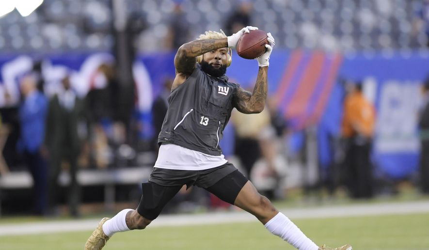 New York Giants wide receiver Odell Beckham catches as pass before an NFL football game against the Detroit Lions Monday, Sept. 18, 2017, in East Rutherford, N.J. (AP Photo/Bill Kostroun)