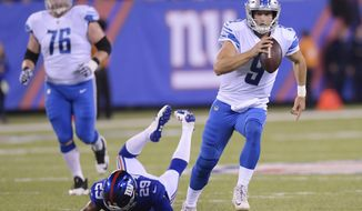 Detroit Lions quarterback Matt Stafford (9) rushes away form New York Giants' Nat Berhe (29) during the first half of an NFL football game, Monday, Sept. 18, 2017, in East Rutherford, N.J. (AP Photo/Bill Kostroun)