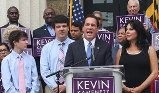 Baltimore County Executive Kevin Kamenetz announces he is joining the race for governor Monday, Sept. 18, 2017, in Towson, Md. Kamenetz is running in a crowded Democratic primary. From left are Kamenetz's sons, Dylan and Karson. His wife, Jill, is standing far right. (AP Photo/Brian Witte)