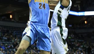 FILE - In this March 1, 2017, file photo, Denver Nuggets center Mason Plumlee, (24) goes up for a basket against Milwaukee Bucks forward Giannis Antetokounmpo during the first half of an NBA basketball game, in Milwaukee. Restricted free agent center Mason Plumlee has agreed to return to the Denver Nuggets on a three-year, $41 million deal. His agent, Mark Bartelstein, confirmed the deal Monday, Sept. 18, 2017, to The Associated Press. (AP Photo/Darren Hauck, File)