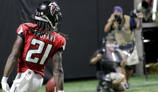 Atlanta Falcons cornerback Desmond Trufant (21) scores a touchdown after Atlanta Falcons outside linebacker Vic Beasley (44) caused Green Bay Packers quarterback Aaron Rodgers (12) to fumble during the second of an NFL football game, Sunday, Sept. 17, 2017, in Atlanta. (AP Photo/David Goldman)