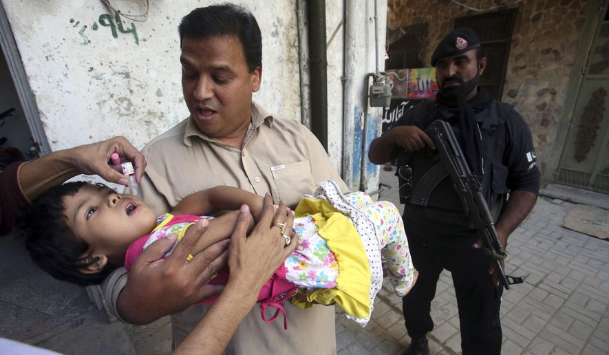A health worker gives a polio vaccine to a child in Peshawar, Pakistan, Monday, Sept. 18, 2017, Polio remains endemic in Pakistan after the Taliban banned vaccinations, instigated attacks targeting medical staffers and spread suspicions about the vaccine. (Muhammad Sajjad)