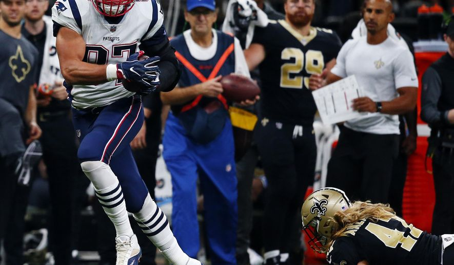 New England Patriots tight end Rob Gronkowski pulls in a touchdown reception in front of New Orleans Saints linebacker Alex Anzalone (47) in the first half of an NFL football game in New Orleans, Sunday, Sept. 17, 2017. (AP Photo/Butch Dill)