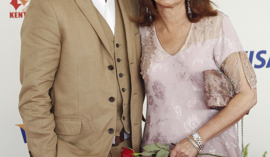 FILE - In this May 3, 2008, file photo, Carson Daly and his mother Pattie Daly Caruso arrive at the 134th Kentucky Derby at Churchill Downs in Louisville, Ky. Daly announced on Monday, Sept. 18, 2017, his mother died the previous day. (AP Photo/David Harpe, File)