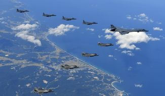In this photo provided by South Korea Defense Ministry, U.S. Air Force B-1B bomber, F-35B stealth fighter jets and South Korean F-15K fighter jets fly over the Korean Peninsula during a joint drills, South Korea on Monday, Sept. 18, 2017. Monday's flyovers came three days after North Korea fired an intermediate-range missile over Japan into the northern Pacific Ocean in apparent defiance of U.S.-led international pressure on the country. The North conducted its sixth nuclear test on Sept. 3 and was subsequently hit with tough, fresh U.N. sanctions.  (South Korea Defense Ministry via AP)
