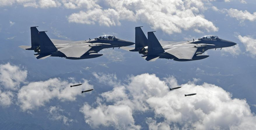 In this photo provided by South Korea Defense Ministry, South Korean F-15K fighter jets drop bombs as they fly over the Korean Peninsula during a joint drills with the U.S., South Korea  on Monday, Sept. 18, 2017. South Korea says the U.S. military has flown powerful bombers and stealth jets over the Korean Peninsula in joint drills with South Korean warplanes. (South Korea Defense Ministry via AP)
