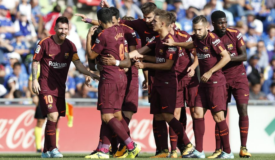 Barcelona's players celebrate a goal against Getafe during a Spanish La Liga soccer match between Getafe and Barcelona at the Alfonso Perez stadium in Getafe, outside Madrid, Saturday, Sept. 16, 2017. Barcelona won 2-1. (AP Photo/Francisco Seco)