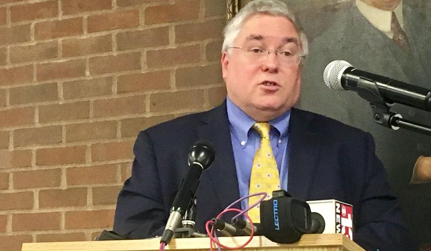 West Virginia attorney general Patrick Morrisey is shown in this Monday, Sept. 18, 2017, photo at a news conference at Marshall University in Huntington, West Virginia. Attorneys general from dozens of states are urging health insurers to review their policies for pain management treatment to spark higher use of alternatives to opioid prescriptions. (AP Photo/John Raby) **FILE**