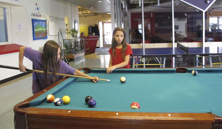 Students from Burlington, Vt., schools play pool at the Pomerleau Family Boys & Girls Club, in Burlington, during the third day of a teachers' strike. Thousands of students in Vermont's largest city are getting extra time off and parents are scrambling to find care for their children as a teachers' strike enters it's third day. The teachers' union and the school board are to meet with a mediator Tuesday, Sept. 19. (AP Photo/Lisa Rathke)