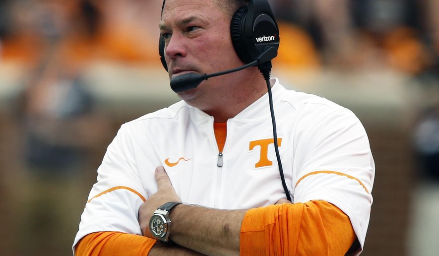FILE - In this Sept. 9, 2017, file photo, Tennessee head coach Butch Jones looks on from the sideline during the first half of an NCAA college football game in Knoxville, Tenn. Tennessee's red-zone woes and its inability to prevent a 63-yard touchdown pass on the final play of a 26-20 loss at Florida on Saturday, Sept. 16, have Volunteers coach Butch Jones facing arguably the most criticism he's encountered since his arrival in Knoxville. (AP Photo/Wade Payne, File)