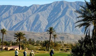 This undated photo provided by San Diego Tourism shows golfers at Borrego Springs Resort Golf Course in San Diego. It's among some 90 golf courses in the San Diego area. Torrey Pines is among some 90 golf courses in the San Diego area. (Joanne DiBona/San Diego Tourism via AP)