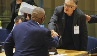 Antigua and Barbuda's Governor General Sir William Rodney, left, and actor Robert De Niro shake hands after they addressed a high-level meeting on Hurricane Irma at the United Nations headquarters, Monday Sept. 18, 2017. (AP Photo/Bebeto Matthews)