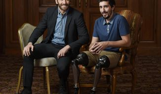 "In this Sept. 10, 2017 photo, Jake Gyllenhaal, left, poses for portrait with Boston Marathon bombing survivor Jeff Bauman during the Toronto International Film Festival in Toronto. Gyllenhaal portrays Bauman in the film ""Stronger."" (Photo by Chris Pizzello/Invision/AP)"