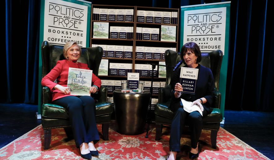 Former Secretary of State Hillary Clinton with Lissa Muscatine at the Warner Theatre in Washington. (Associated Press)