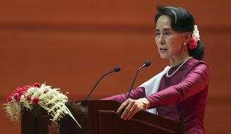 Myanmar's State Counsellor Aung San Suu Kyi delivers a televised speech to the nation at the Myanmar International Convention Center in Naypyitaw, Myanmar, Tuesday, Sept. 19, 2017. After a mass exodus of Rohingya Muslims sparked allegations of ethnic cleansing, Suu Kyi said her country does not fear international scrutiny. (AP Photo)