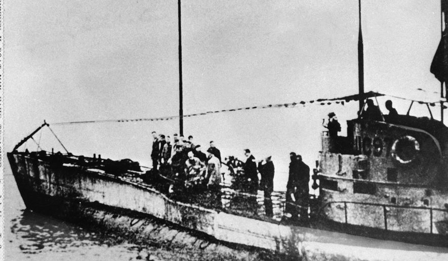 In this undated photo people stand on the deck of a World War I German submarine type UC-97 in an unknown location. Belgian regional authorities on Tuesday, Sept. 19, 2017, say that an intact German World War I submarine has been found off the coast of Belgium. (AP Photo, File)