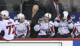 Washington Capitals head coach Barry Trotz talks to his players during the second period of an NHL hockey game against the New Jersey Devils Monday, Sept. 18, 2017, in Newark, N.J. (AP Photo/Mel Evans)