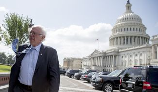 Sen. Bernie Sanders, I-Vt., arrives at a rally of health care advocates, grassroots activists, and others outside the Capitol in Washington, Tuesday, Sept. 19, 2017. Senate Republicans begin another push to repeal the Affordable Care Act with the Graham-Cassidy proposal. (AP Photo/Andrew Harnik)