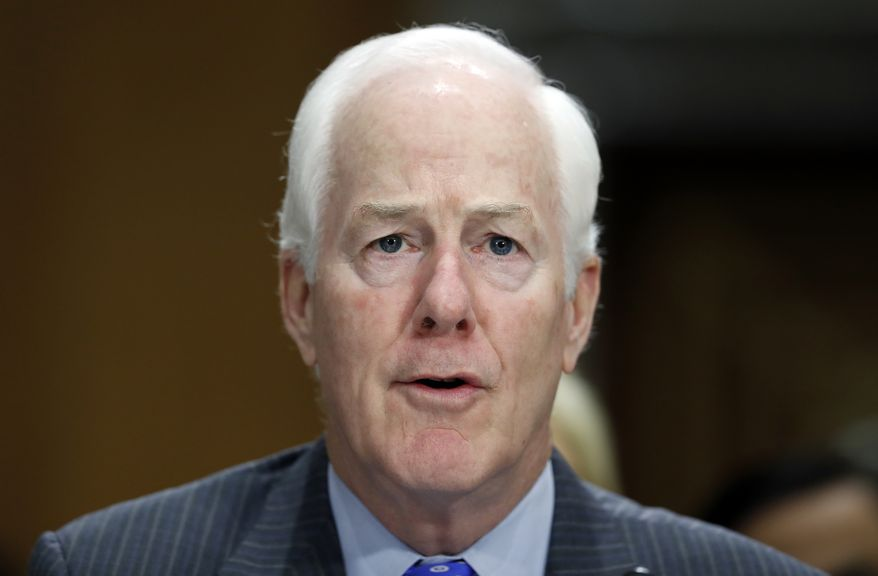 Sen. John Cornyn, R-Texas, testifies during a hearing of the Senate Foreign Relations Committee on the nomination of former Utah Gov. Jon Huntsman to become the US ambassador to Russia, on Capitol Hill, Tuesday, Sept. 19, 2017 in Washington. (AP Photo/Alex Brandon)