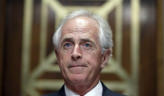 Chairman Bob Corker, R-Tenn., pauses before a hearing of the Senate Foreign Relations Committee on the nomination of former Utah Gov. Jon Huntsman to become the US ambassador to Russia, on Capitol Hill, Tuesday, Sept. 19, 2017 in Washington. (AP Photo/Alex Brandon)