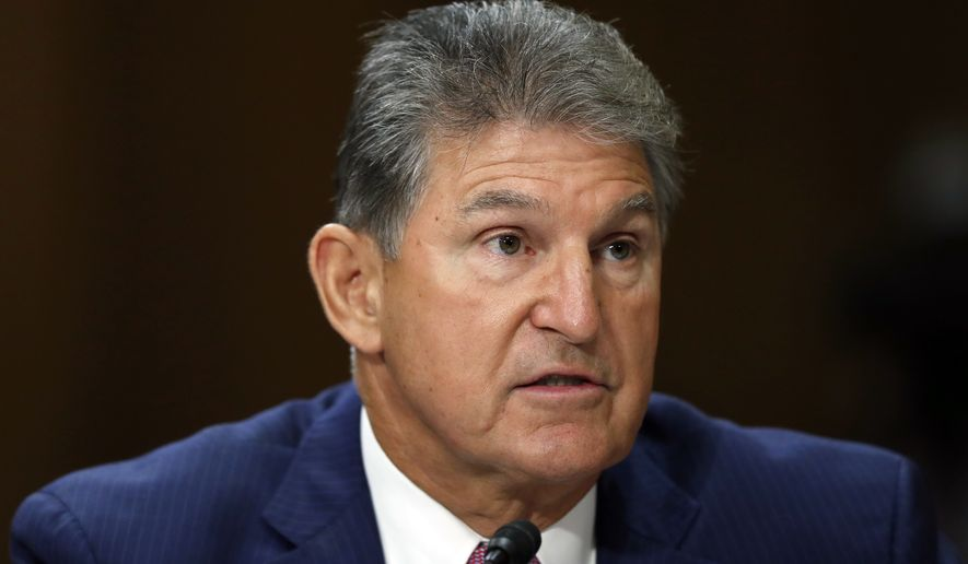 Sen. Joe Manchin, D-W.Va., testifies during a hearing of the Senate Foreign Relations Committee on the nomination of former Utah Gov. Jon Huntsman to become the US ambassador to Russia, on Capitol Hill, Tuesday, Sept. 19, 2017 in Washington. (AP Photo/Alex Brandon)