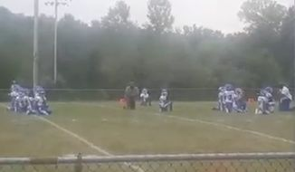 A team of 8-year-old football players and their coaches took a knee during the national anthem in Belleville, Illinois, on Sunday as a demonstration of solidarity with St. Louis protesters. (Facebook/@Latia Cole-Gooden via Belleville News-Democrat)